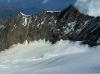 Po krátkom opájaní sa vrcholovými výhľadmi  sa vydávame na zostupovú perepúť